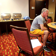 Head coach Tod Kowalczyk studies film before breakfast at the hotel in Muncie, Ind., on Saturday, February 17, 2018. The Rockets took on the Cardinals later in the afternoon. THE BLADE/KURT STEISS