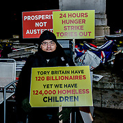 Protest 24 Hours Hunger Strike Tories out at Parliament Yard , on 11 December 2018, London, UK.