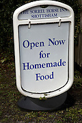 Pub sign open for homemade food