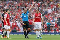 Football - Premiership - Arsenal vs. Liverpool<br /> <br /> Referee Martin Atkinson sends off Arsenal's Emmanuel Frimpong after a second yellow at The Emirates Stadium