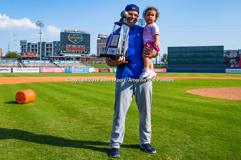 Amarillo Sod Poodles hitting coach Raul Padron poses with the trophy after the Sod Poodles won against the Tulsa Drillers during the Texas League Championship on Sunday, Sept. 15, 2019, at OneOK Field in Tulsa, Oklahoma. [Photo by John Moore/Amarillo Sod Poodles]