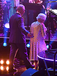 Queen Elizabeth II and the Prince of Wales leave the stage at the Royal Albert Hall in London during a star-studded concert to celebrate the Queen's 92nd birthday.