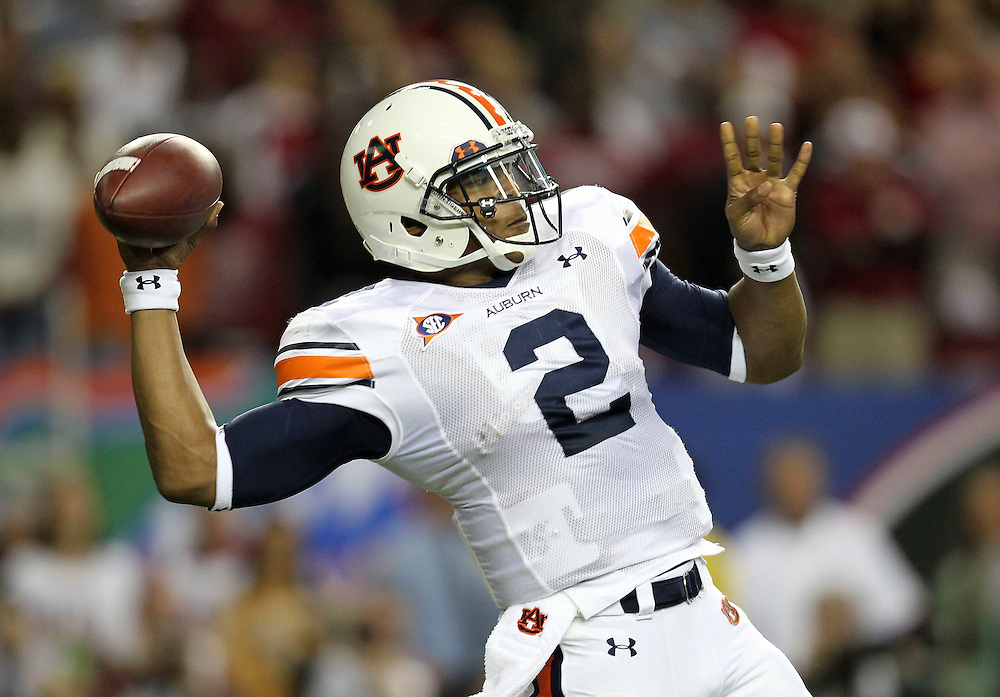 ATLANTA - DECEMBER 4:  Quarterback Cam Newton #2 of the Auburn Tigers throws a pass during the 2010 SEC Championship against the South Carolina Gamecocks at Georgia Dome on December 4, 2010 in Atlanta, Georgia. (Photo by Mike Zarrilli/Getty Images)