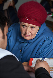 A woman consults with Dr Mohsin Mehraj at the MSF mobile clinic in the village of Gorodishe, near Lugansk.