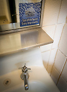 """A sticker reminds state park guests to """"Take Care of Texas"""" by turning off the faucet at a Lake Arrowhead State park restroom on April 28, 2014. Lake Arrowhead State park is just south of Wichita Falls, Texas and the lake provides the town with drinking water."""