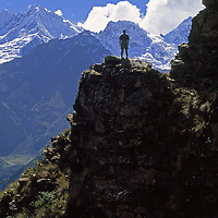 Cordillera Vilcabamba, Cuzco District, Andes Mountains, Peru. A trekker overlooks Nevado Sacsarayoc from Victoria Pass.