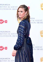 Julia Stiles attending the Virgin Media BAFTA TV awards, held at the Royal Festival Hall in London. Photo credit should read: Doug Peters/EMPICS