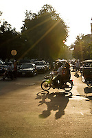 Three on a Bike in Phnom Penh, Cambodia