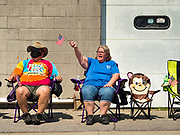 04 JULY 2020 - RUNNELLS, IOWA: Spectators cheer during the 4th of July tractor parade in Runnells, a small community about 25 miles from Des Moines. Most of the Independence Day parades in central Iowa were cancelled because of the COVID-19 (Coronavirus) pandemic. People in Runnells made the decision to go ahead with their parade, the first 4th of July parade in the town in recent memory. Most of the people in the parade were farmers, who drove their tractors through the town.     PHOTO BY JACK KURTZ
