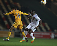 John Akinde of Barnet ® is tackled by Paul Bignot of Newport county. EFL Skybet football league two match, Newport county v Barnet at Rodney Parade in Newport, South Wales on Tuesday 25th October 2016.<br /> pic by Andrew Orchard, Andrew Orchard sports photography.