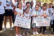 """June 13 - PHOENIX, AZ: A children's choir performs at an immigrants' rights rally and vigil at the Arizona State Capitol Sunday. About 40 immigrants' rights activists from Anaheim, California, joined Phoenix area activists at the Arizona State Capitol Sunday for a prayer vigil and rally against SB 1070, the Arizona law that gives local law enforcement agencies the power to ask to see proof of immigration status in the course of a """"lawful contact"""" and when """"practicable."""" Immigrants' rights and civil rights activist say the bill will lead to racial profile. Proponents of the bill say it is the toughest local anti-immigration bill in the country and merely brings state law into line with federal immigration law.  The law, which was signed by the Arizona Governor in April, goes into effect on July 29, 2010.   Photo by Jack Kurtz"""