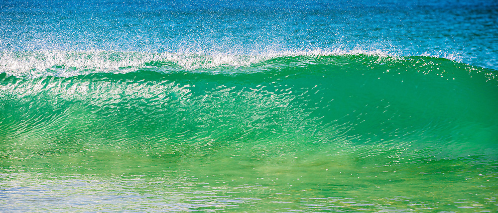 Wave breaking at Dicky Beach, Sunshine Coast, Queensland, Australia