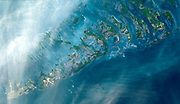 The Florida Keys are a chain of islands, islets and reefs extending from Virginia Key to the Dry Tortugas. October 28, 2001. Satellite image.