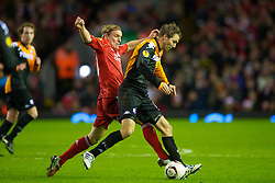 LIVERPOOL, ENGLAND - Wednesday, December 15, 2010: Liverpool's Christian Poulsen and FC Utrecht's Michael Silberbauer during the UEFA Europa League Group K match at Anfield. (Photo by: David Rawcliffe/Propaganda)