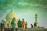 Reflection of a group of tourists in a courtyard pool of water, Taj Mahal, Agra, India