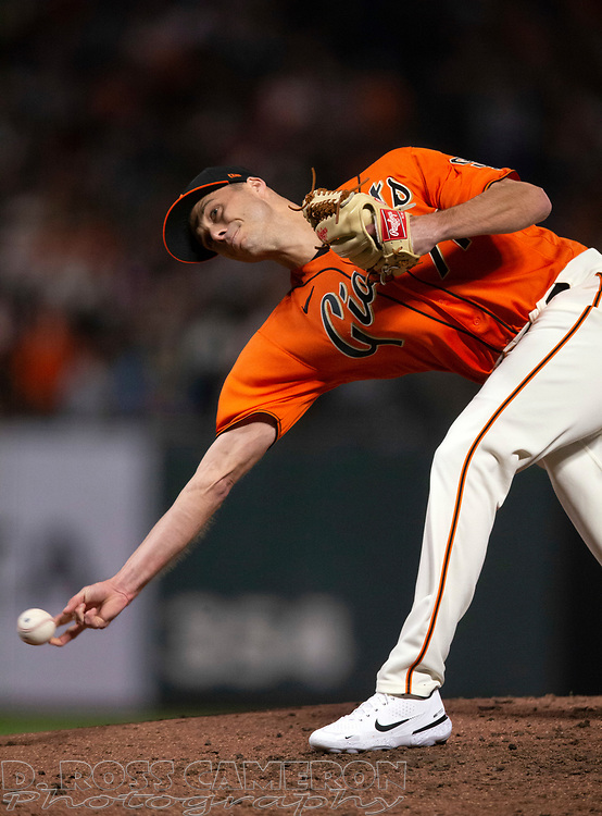 Oct 1, 2021; San Francisco, California, USA; San Francisco Giants pitcher Tyler Rogers (71) delivers a pitch against the San Diego Padres during the eighth inning at Oracle Park. Mandatory Credit: D. Ross Cameron-USA TODAY Sports