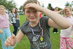 Group of girls taking part in a Superhero workout at a Parklife summer activities event,