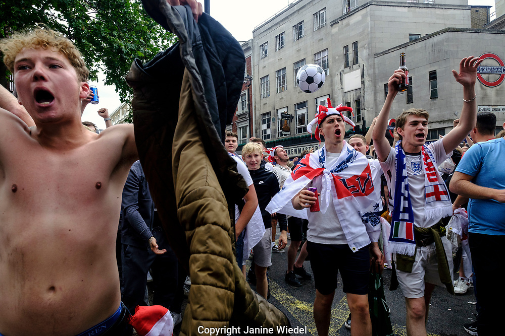 English Football fans in Chring Cross road, Leicester Square in central London before the finals of football match against Italy.  England v Italy Euro 2020 final. 11 July 2021