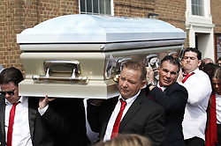 © Licensed to London News Pictures. 21/04/2018. Cobham, UK. Paddy Dohrty (centre on right) with his brothers carries the coffin of his mother of Queenie, Elizabeth Doherty at Sacred Heart Church in Cobham, Surrey. Elizabeth Doherty, whose son Paddy Doherty is known for appearing on My Big Fat Gypsy Wedding and winning Celebrity Big Brother 8, died of a heart attack earlier this month. Paddy Doherty claimed his mother has died of a 'broken heart' following the death of her husband almost a year ago. Photo credit: Peter Macdiarmid/LNP