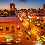 Street scene on the Country Club Plaza in Kansas City during the holidays depicting the Plaza Lights decorating the area for the Christmas season.