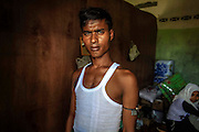 BAYEUN, ACEH, INDONESIA - JULY 11 : <br /> Rohingya migrant pose to photograph at temporary shelter camp in Bayeun, East Aceh, Indonesia on July 11. 2015. The boatpeople in Aceh are among thousands of Rohingya and Bangladeshi migrants who arrived in countries across Southeast Asia in May after a Thai crackdown threw the people-smuggling trade into chaos.<br /> ©Nira Cahaya/Exclusivepix Media