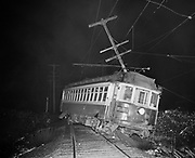 Y-471224-01. Trolley accident, derailed, at 128th & Foster. Trolley #1100, Bellrose. December 24, 1947. Night photo.