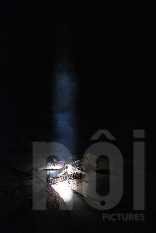 Light falls on an old film strip in the abandoned Bouasavanh cinema, Vientiane, Laos, Southeast Asia