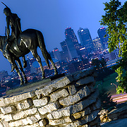 Kansas City's Scout Statue in Penn Valley Park at dusk, overlooking the downtown Kansas City MO skyline.