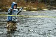 Liberty High School student Matt Abrams holds a measuring tape while standing in the middle of the Neversink River on Nov. 8, 2006, in Hasbrouck. Liberty students were at the river to test water quality.