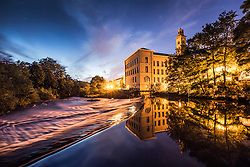 © Licensed to London News Pictures. 25/08/2015. Saltaire, UK. Picture shows first light at Salts Mill in the World Heritage village of Saltaire. Yorkshire woke to bright sunshine this morning although a cloudy afternoon is expected. Photo credit: Andrew McCaren/LNP