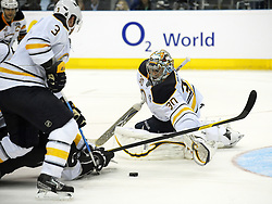 08.10.2011, O2 World, Berlin, Linz, GER, NHL, Buffalo Sabres vs LA Kings, im Bild Goalkeeper Ryan Miller with a save and Jordan Leopold (Buffalo Sabres, #30 and #) and Drew Doughty (LA Kings, #8), during the Compuware NHL Premiere, O2 World Berlin, Berlin, Germany, 2011-10-08, EXPA Pictures © 2011, PhotoCredit: EXPA/ Reinhard Eisenbauer