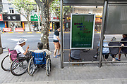 Elderly residents gather around a bus stop to chat and gossip near an old neighborhood area slated for redevelopment in Shanghai, China, on Monday, Aug. 15, 2016.