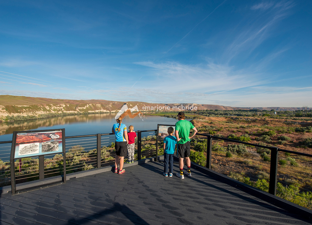 Family enjoying scenic overlook and interpretive signs at Hagerman Fossil Beds National Monument, Hagerman, Idaho. MR