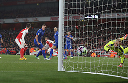 26 April 2016 London : Premier League Football : Arsenal v Leicester City :<br /> Nacho Monreal watches as his shot deflects past City goalkeeper Schmeichel to score the opening goal for Arsenal.<br /> Photo: Mark Leech
