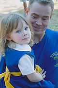 Father holds daughter in folk costume of Sweden. Svenskarnas Dag Swedish Heritage Day Minnehaha Park Minneapolis Minnesota USA