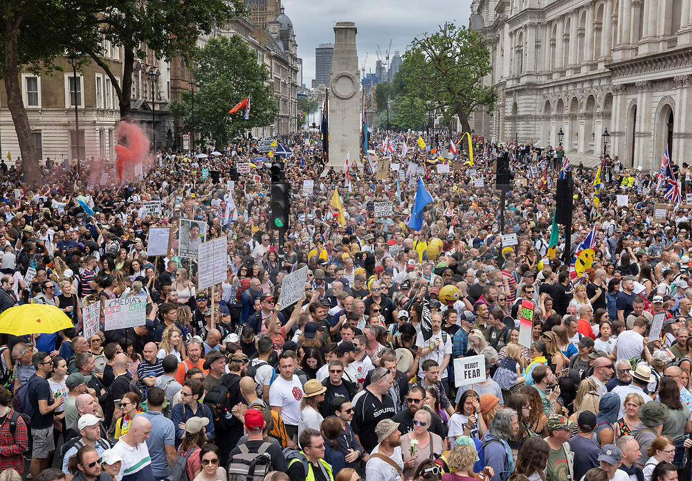 © Licensed to London News Pictures. 26/06/2021. London, UK. Anti-lockdown protesters fill Whitehall outside the entrance to Downing Street in central London. Various groups are marching in central London today calling for freedom and an end to lockdown regulations. Photo credit: Peter Macdiarmid/LNP