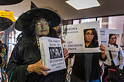31 OCTOBER 2013 - PHOENIX, AZ: An immigration protester dressed as a Halloween witch holds a press conference to protest anti-immigrant actions taken by Arizona Governor Jan Brewer this year. About 20 supporters of the DREAM Act and the deferred action program of President Barack Obama visited the office of Arizona Governor Jan Brewer to protest her decision to deny drivers licenses to Arizona DREAMERS and immigrants granted deferred action status by immigration authorities. The protest was a part of ongoing series of actions by immigration rights activists in Arizona to protest against anti-immigrant actions taken by Arizona political leaders.     PHOTO BY JACK KURTZ