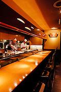 Michihiro Kigawa preparing food at open kitchen at Kigawa restaurant.