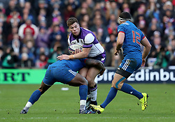 Scotland's Huw Jones (centre) is tackled during the NatWest 6 Nations match at BT Murrayfield, Edinburgh.