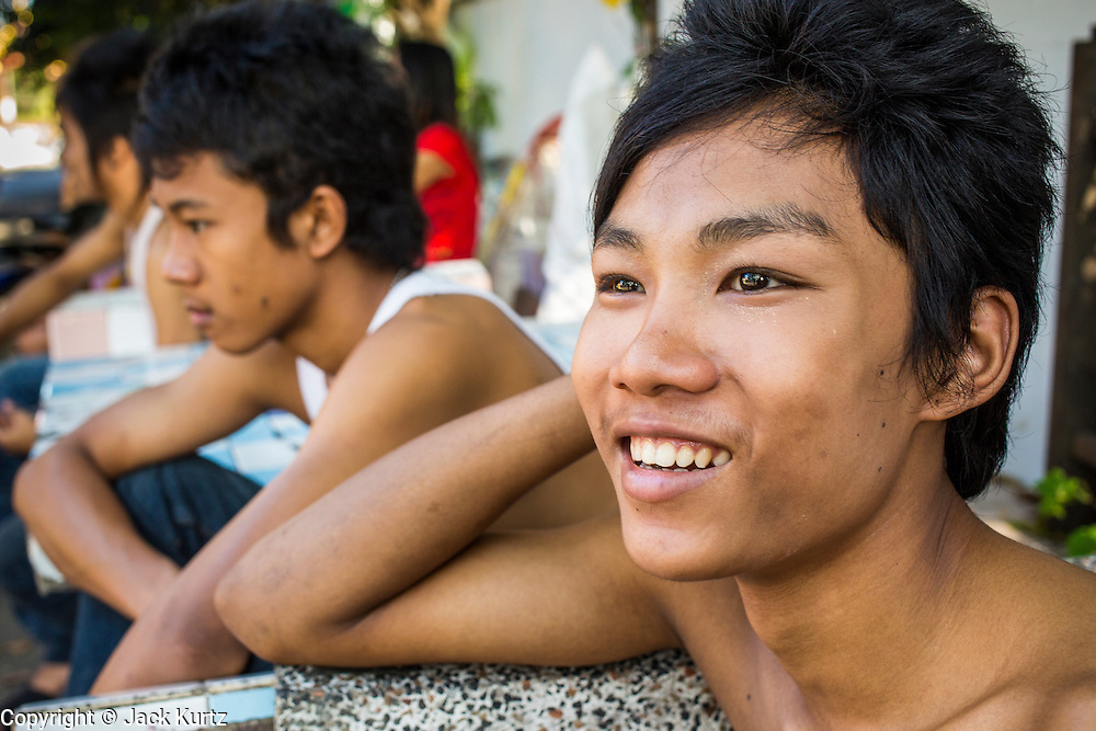 13 JANUARY 2013 - BANGKOK, THAILAND:  Thai teenagers in the Bang Luang neighborhood in Bangkok. The Bang Luang neighborhood lines Khlong (Canal) Bang Luang in the Thonburi section of Bangkok on the west side of Chao Phraya River. It was established in the late 18th Century by King Taksin the Great after the Burmese sacked the Siamese capital of Ayutthaya. The neighborhood, like most of Thonburi, is relatively undeveloped and still criss crossed by the canals which once made Bangkok famous. It's now a popular day trip from central Bangkok and offers a glimpse into what the city used to be like.    PHOTO BY JACK KURTZ