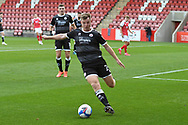 Tony Craig (24) of Crawley Town clears the ball during the EFL Sky Bet League 2 match between Cheltenham Town and Crawley Town at Jonny Rocks Stadium, Cheltenham, England on 10 October 2020.