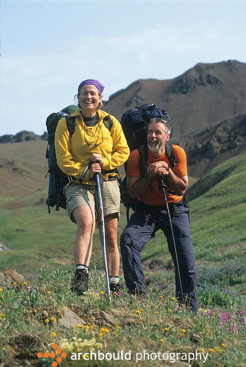 Back packing couple on Donjek Glacier hike in Kluane National Park