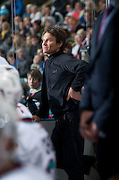 KELOWNA, CANADA - DECEMBER 30: Scott Hoyer, athletic therapist of the Kelowna Rockets stands on the bench against the Everett Silvertips on December 30, 2015 at Prospera Place in Kelowna, British Columbia, Canada.  (Photo by Marissa Baecker/Shoot the Breeze)  *** Local Caption *** Scott Hoyer;