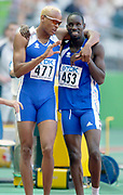 Marc Raquil (477) and Leslie Dijohne (463) of France celebrate in the second round of the 400-meter finals after both advanced to the final in the IAAF World Championships in Athletics at Stade de France on Sunday, Aug, 24, 2003.