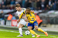 Tottenham Hotspur defender Ben Davies (left) and Juventus forward Douglas Costa in action during the Champions League match between Tottenham Hotspur and Juventus FC at Wembley Stadium, London, England on 7 March 2018. Picture by Toyin Oshodi.