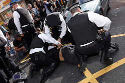 © Licensed to London News Pictures.  11/09/2011. LONDON, UK. English Defence League (EDL) and Muslims Against Crusades (MAC) supporters clash following rival protests outside the US Embassy in Grosvenor Square, London. Photo credit : Cliff Hide/LNP