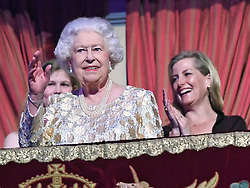 Queen Elizabeth II takes her seat at the Royal Albert Hall in London to attend a star-studded concert to celebrate her 92nd birthday.
