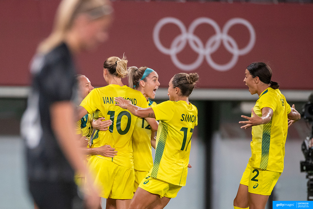 TOKYO, JAPAN - JULY 21: Tameka Yallop, 13, of Australia celebrates with team mates after scoring her sides first goal during the Australia V New Zealand group G football match at Tokyo Stadium during the Tokyo 2020 Olympic Games on July 21, 2021 in Tokyo, Japan. (Photo by Tim Clayton/Corbis via Getty Images)