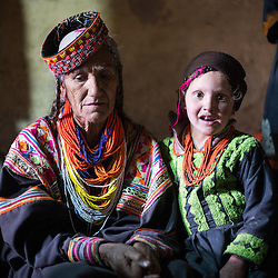 Bumburet, Chitral District,Pakistan.Pic Shows  Kalash woman and children in the Kalash village in the valley of Bumburet