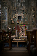 A damaged statue of Jesus stands inside the Syriac Catholic Church of the Immaculate Conception in Qaraqosh, Iraq. The church and the entire town suffered heavy damage during the two-year ISIS occupation from 2014 to 2016. Qaraqosh is the largest Christian town in Iraq. (May 20, 2017)